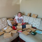 Hannah surrounded by cards